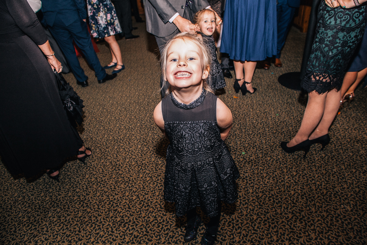 child smiling wedding guest